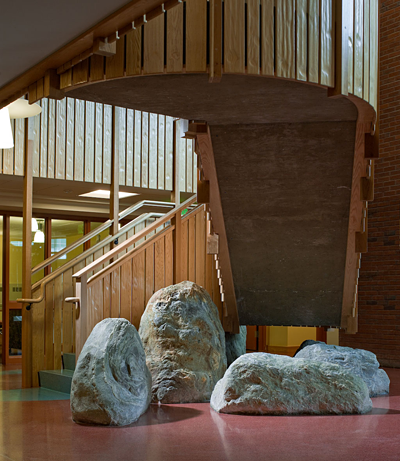 Local boulders found on the construction site anchor the building to the Earth and offer casual locations for students and faculty to pause
