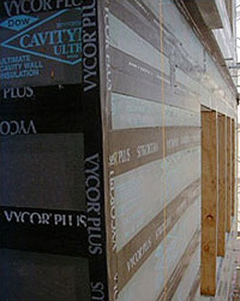 Figure 18: Photo showing foam sealant applied to all insulation board edges followed by peel-and-stick modified asphalt tape on the primed insulation sheathing boards used as the air barrier.
