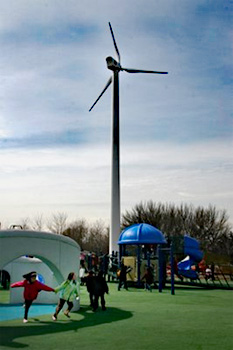 Wind turbine installed near the playground of an elementary school