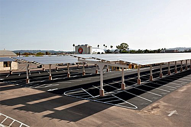 PV collectors mounted on structures so they also provide shade to the cars that park beneath them