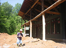 Photo of a child outside a house under construction