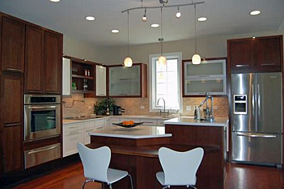 kitchen in the LIFEhouse with its many levels of lighting, multiple work center levels, and fixtures and appliances with universal design features