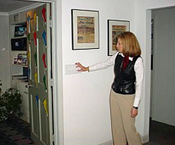 woman operating a lightswitch in her workplace