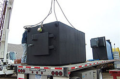 Photo showing the delivery of a combustor and boiler on the back of a semi truck in Boulder County, Colorado