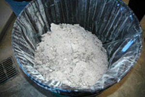 Photo of a can filled with ash created by wood combustion