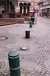 retractable bollards along a pavered street