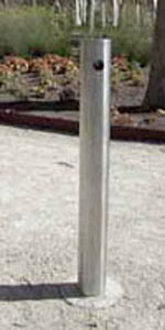 single stainless steel bollard secured in gravel in park