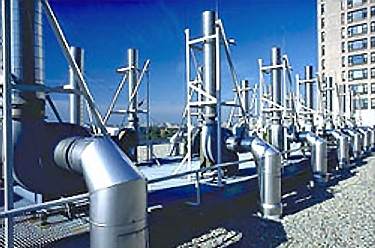 Photo of HVAC equipment mounted on a building's rooftop