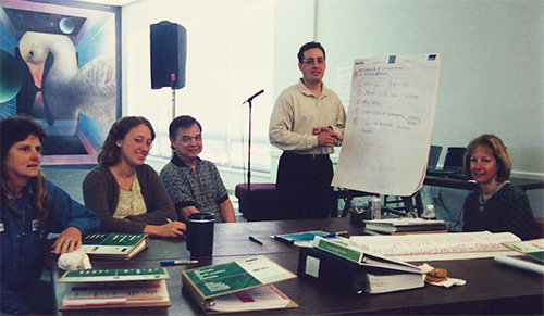 Charrette work group participants work with the facilitator to capture ideas on flip chart.