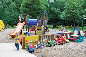 playground with a mix of sand play area, hard surface zone, and gross motor skills area