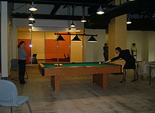 The de-stress space supports group social occasions, exercise, and pool playing during breaks