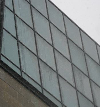 Snow and ice adhering to a building curtain wall