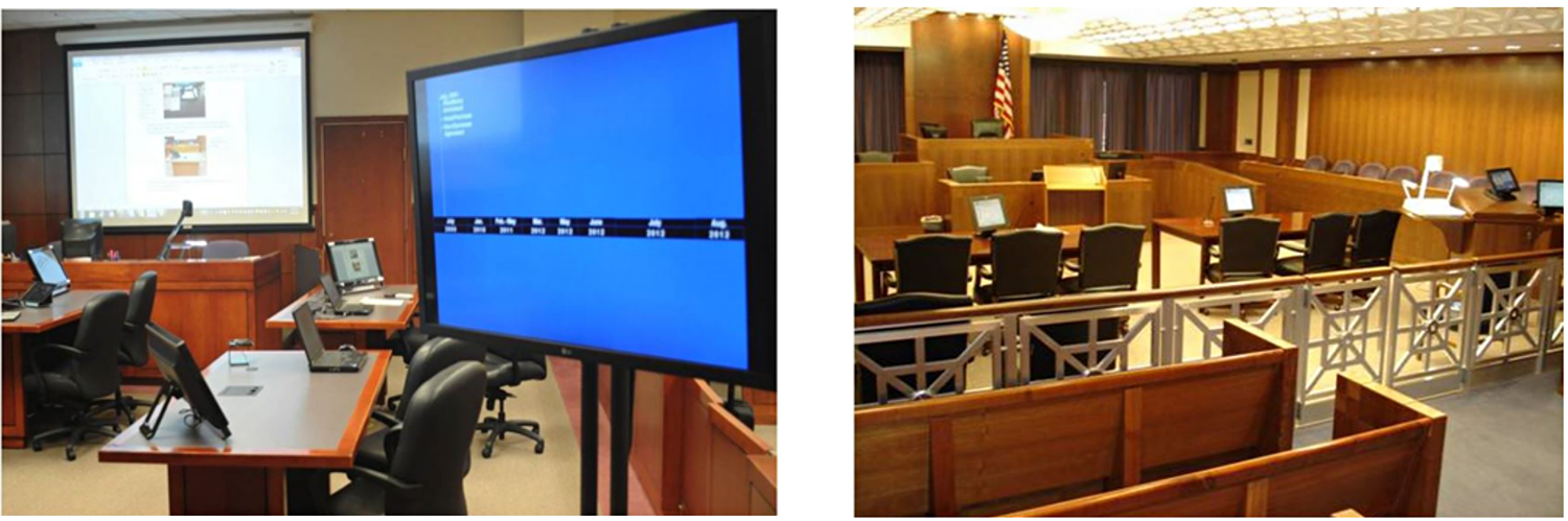 Picture of courtroom with mulitple devices to present information