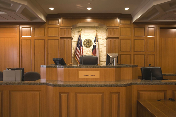 This judge's bench is raised for optimal viewing across the courtroom and to create the sightlines and hierarchy necessary for the courtroom's proceedings