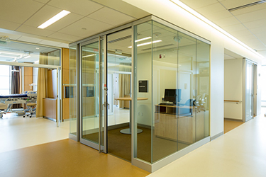 hallway with glass-walled room for computer at Christ Hospital Joint and Spine Center