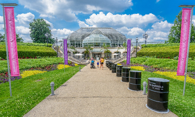 Entrance to Phipps with 16 oil barrels along the sidewalk