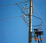 Photo 1A Utility service equipment on a pole