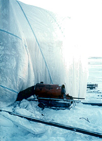 BUR being applied during very cold weather, which should not be permitted, with warm air being blown into an air-supported enclosure