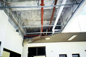 Photo of a collasping metal soffit that was not designed for upward-acting wind pressure