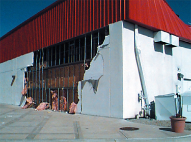 EIFS blow-off near a wall corner