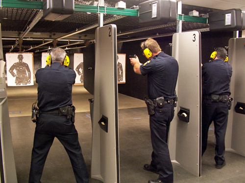 Three law enforcement officers pictured in close target range training