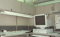 Photo of an office cubicle with task lighting