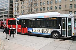 Photo of a city bus displaying an ad proclaiming New Jersey A State of Resilience