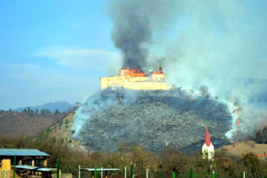 Alternate view of Krasna Horka Castle burning.
