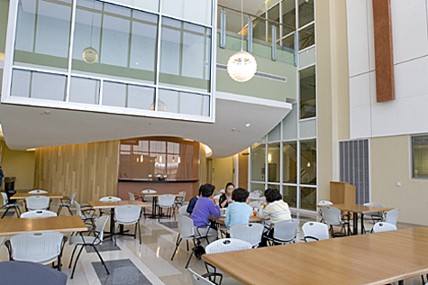 Large tables and seating areas outside labs and offices