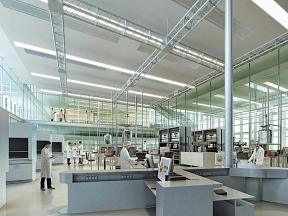 Interior photo of lab within PetroChina with very high ceilings allowing a lot of daylight; it is very open and uses a lot of glass, even the catwalk has glass walls, and h