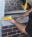 applying sealant at wall