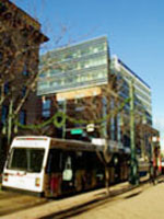 The pedestrian avenue with a bus passing by in front of the EPA Region 8 Headquarters in Denver CO
