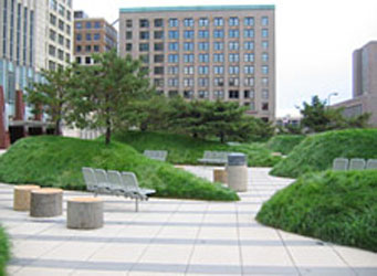 Plaza area of the Federal Courthouse, Minneapolis, MN featuring green turf berms and bollard-type seating elements