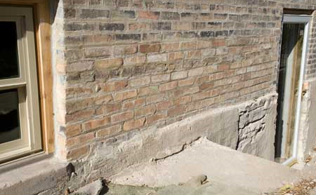 Photo of exterior building wall with sacrificial parging layer