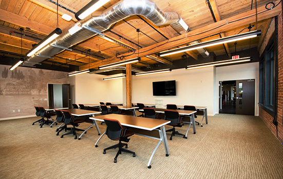 Carefully placed wireless access points, room speakers, sound-masking speakers, and structured cabling provide the connectivity and collaboration this interactive space requires while still keeping the original rustic beams in place.
