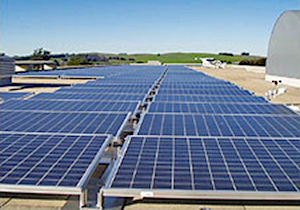 Rooftop of the U.S. Coast Guard (USCG) Training Center in Petaluma, California with a multiple arrays of photovoltaic solar modules