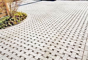 Photo of a large patio walkway that uses pervious pavers in a basket weave pattern