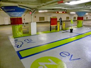 Interior of the Boston Common Garage Authority EV charging stations and zipcar sharing spaces