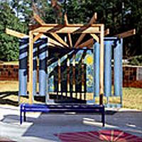 Custom-designed wooden playground structure of a theater stage