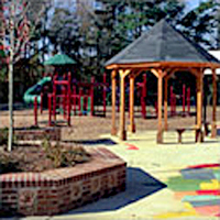 Playground Comfort/Social Zone with a gazebo, benches, and brick planter seating