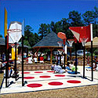 Playground Hard Surface Zone showing a red polka-dot surface for sidewalk games. It also features the game Bankshot Basketball