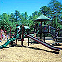 Playground equipment installed in the Gross Motor Zone with sides, climbing ladders, and cross bar equipment