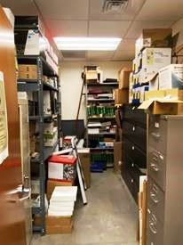 overcrowded supply closet