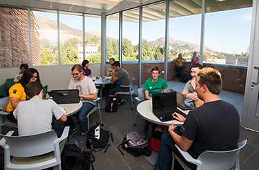 Interior open space with students studying and gathering in the Warren J. Baker Center for Science and Mathematics at Cal Poly, San Luis Obispo, CA