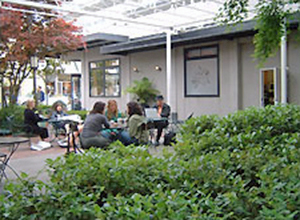 People sitting at an outdoor cafe.