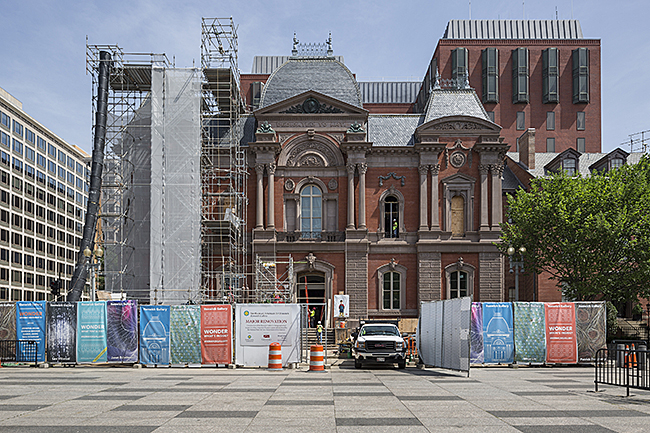Exterior of the Renwick Gallery, Smithsonian American Art Museum with scaffolding and protective screening installed during construction.
