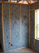 example of a wall with cellulose loose fill insulation installed between the wall joists