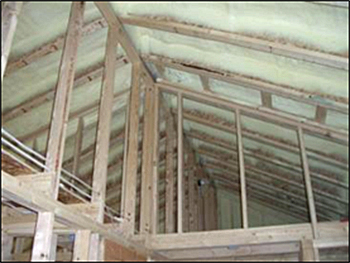 Example of spray polyurethane foam insulation in ceiling joists