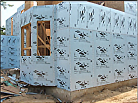 Example of rigid foam board insulation on the exterior of a house under construction
