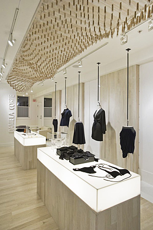Retail space with light up counters and merchandise hanging from ceilings